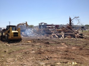 Cleaning up tornado damage in Mayflower