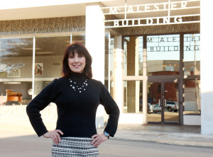 SAU ASBTDC client Becky Jones in front of the McAlester Building in Magnolia